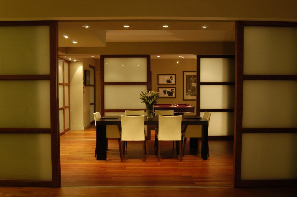 The dining room and pool room are surrounded by sliding glass doors
