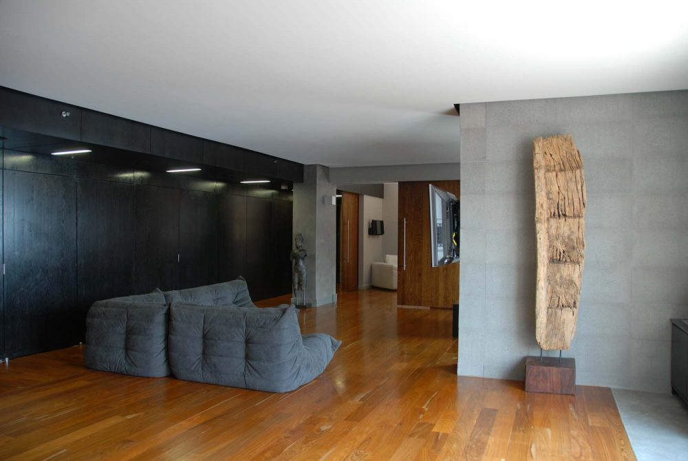 Apart from acting as a living room, the main space is a place for the clients to display their collection of art objects