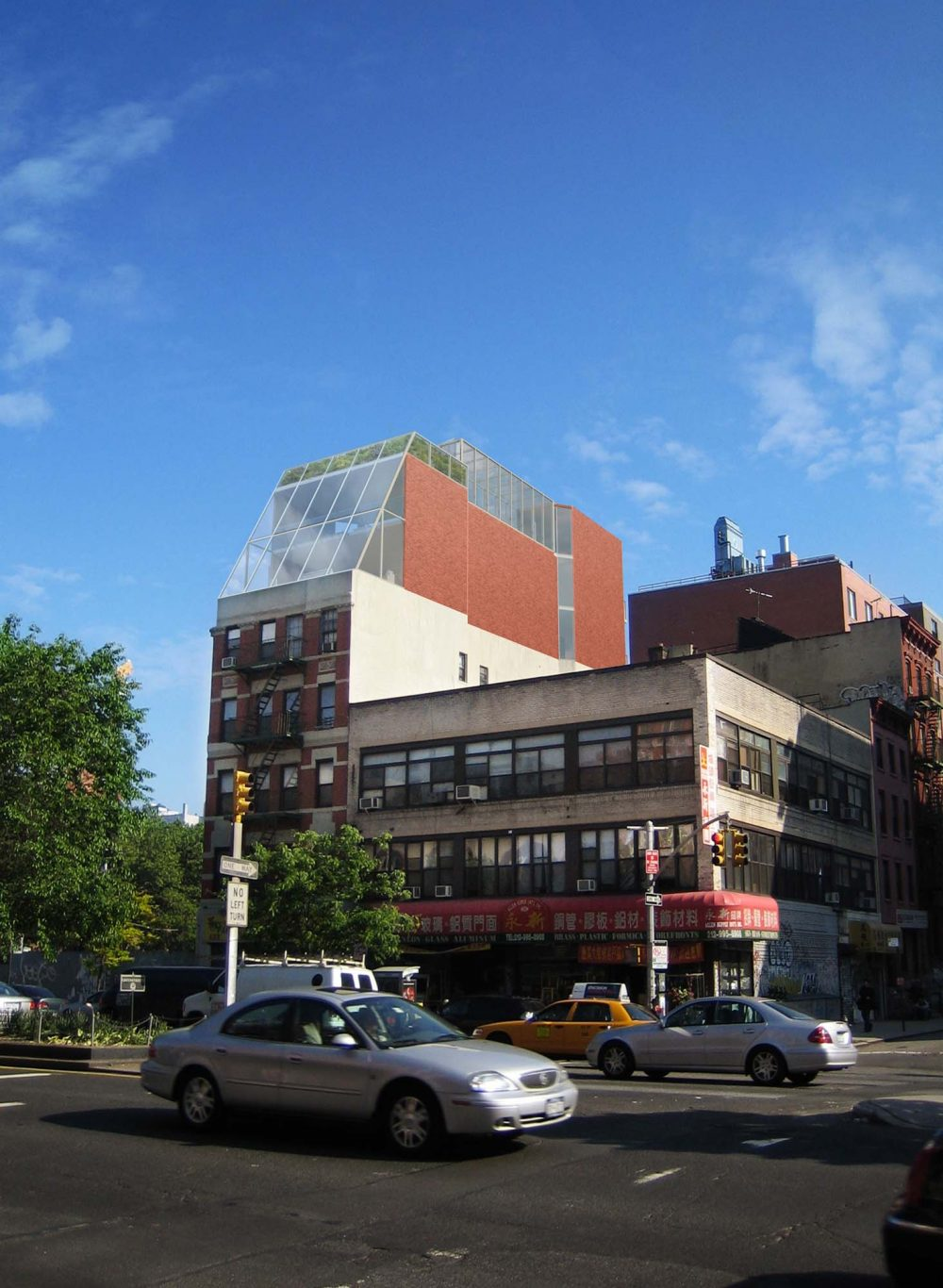 A rendering of the proposed addition to the existing building viewed from Delancey Street