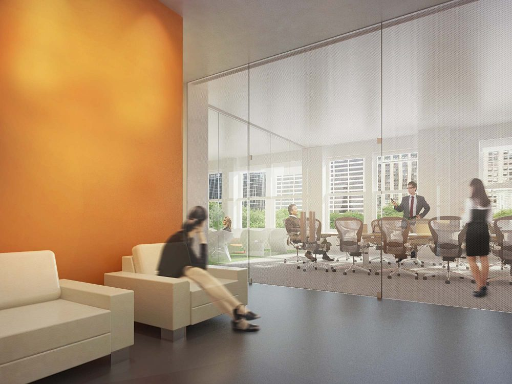 The entrance lobby has views through the conference room to the city and park outside