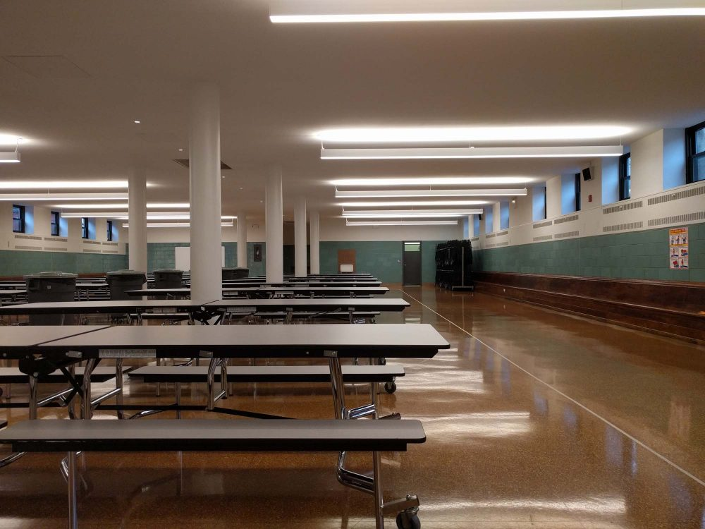 The multipurpose space in the basement can be configured into a cafeteria, assembly space, or gym, depending on the school's requirements
